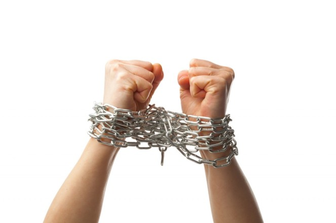 bigstock-two-chained-fists-isolated-on-26921144-1024x682
